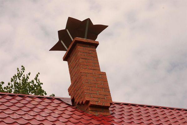 Установка трубы на крыше из профнастила