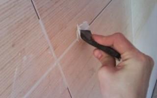 Как снять плиточный клей со стены